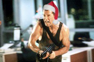 Bruce Willis in Die Hard wearing santa hat