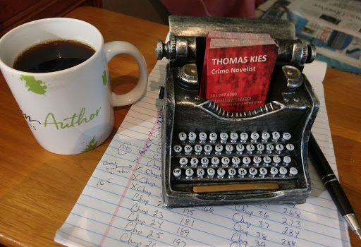Thomas Kies business cards in stypewriter-style business card holder with note pad and coffee cup